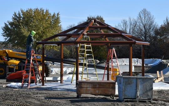 Work continues to erect a gazebo at the new skate plaza Tuesday, Oct. 29, 2019, in St. Cloud.