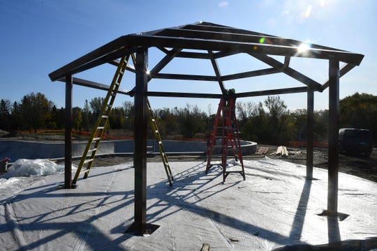 A gazebo shelter is put into place at the new skate plaza Tuesday, Oct. 29, in St. Cloud.