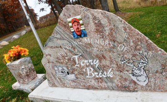 A memorial for Terry Brisk is installed near where he was killed Nov. 7, 2016, near Little Falls.