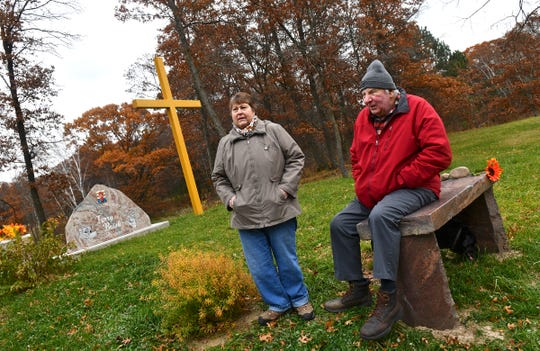 Virgil and Babe Brisk talk about their son Terry at a memorial in his honor Wednesday, Oct. 30, 2019, on the family land near Little Falls. Terry Brisk was found dead Nov. 7, 2016, on the land.