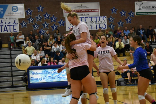 Dixie volleyball celebrates a point against Desert Hills during the regular season.