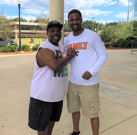 FAMU women's basketball coach Kevin Lynum (right) played free safety at Hawthorne High School under Rattler alum Marian Chisolm. He was the associate head coach of the football team.