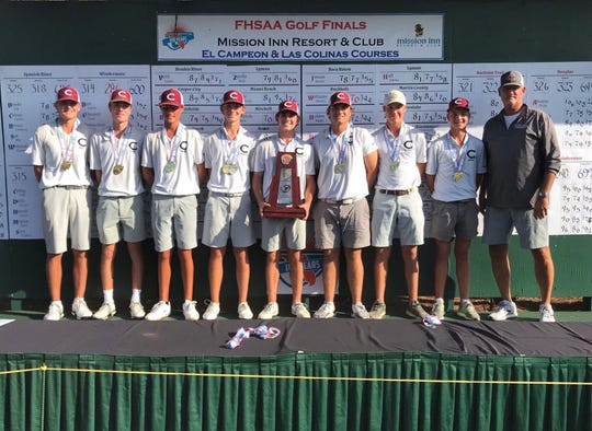 Chiles' boys golf team captured a Class 3A state championship, its first, on Wednesday, Oct. 30, 2019 at Mission Inn Resort & Club in Howey-in-the-Hills. Junior Patrick McCann shot 5-under over two days to finish in a tie for third overall as the Timberwolves won by eight strokes. From left: Parker Bell, Jake Springer, Aiden Ash, Patrick McCann, Trey Buehler, Tank Lawson, Sanders O'Kelley, Taylor Bell, coach Ken Smith.
