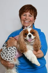 Karen Eccleston with Oakley, her pet therapy dog who participates in Misty's Pals, one of the Humane Society of the Treasure Coast's education programs.