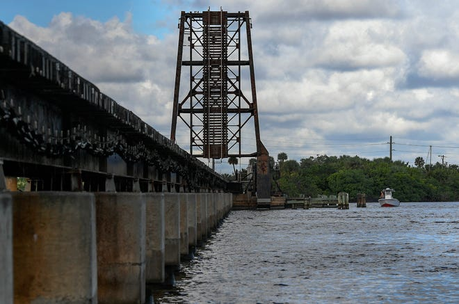 The Florida East Coast railroad bridge is seen spanning the St. Lucie River, parallel to the Roosevelt Bridge, on Wednesday, Oct 30, 2019, in Stuart. Virgin Trains USA has announced their intentions to replace the aging bridge, a single track span, with a double-track span costing around $100 million and taking around two years to build.