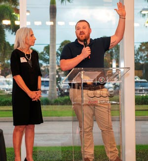 """Erica Garwood and former scholarship winner Christopher Collins at the Mark Garwood SHARE Foundation 2020 Phoenix Scholarship Night.  """"Getting sober is easy. Building a life is hard,"""" said Collins."""