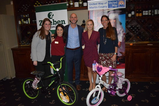 Zweben Law Group invites the public to its Bike Drive Kickoff Party on Nov. 22 at the Dolphin Bar & Shrimp House in Jensen Beach. Pictured are, from left, Kristen Bishop, Tara Zweben, Gene Zweben, Marcie King and Shari McGlynn.