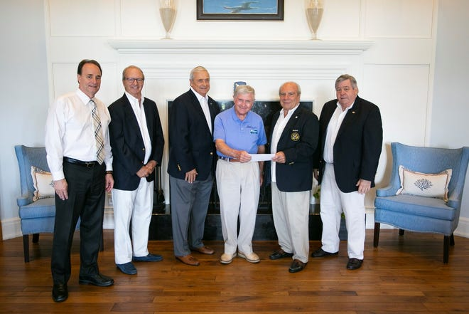 Wheels & Keels Foundation board members present a donation to the Youth Sailing Foundation. Pictured are, from left, Craig Lopes, Gordon Sulcer, Vince DeTurris, Stuart Keiller, Gavin Ruotolo and George O'Malley.