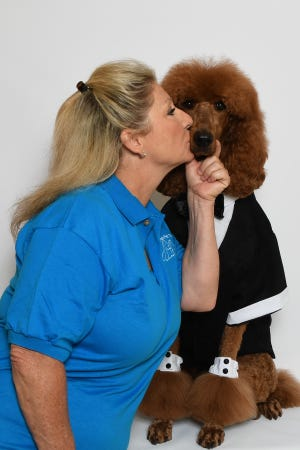 Tracy Baldwin shows some love to Lance, her pet therapy dog who participates in Misty's Pals, one of the Humane Society of the Treasure Coast's education programs.