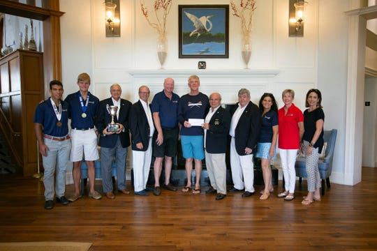 Wheels & Keels Foundation board members present a donation to Vero Beach Rowing officials and rowers. Pictured are, from left, Eddie Pines, Evan Losey, Vince DeTurris, Gordon Sulcer, Chris Ryan, Bryan Colgan, Gavin Ruotolo, George O'Malley, Shotsie LaJoie, Patty Gleason and Catalina Pines.