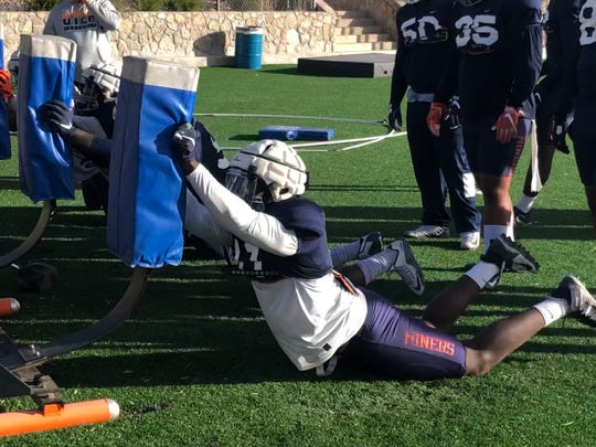 UTEP defensive end Denzel Chukwukelu  competes in a drill during Wednesday's practice at Glory Field