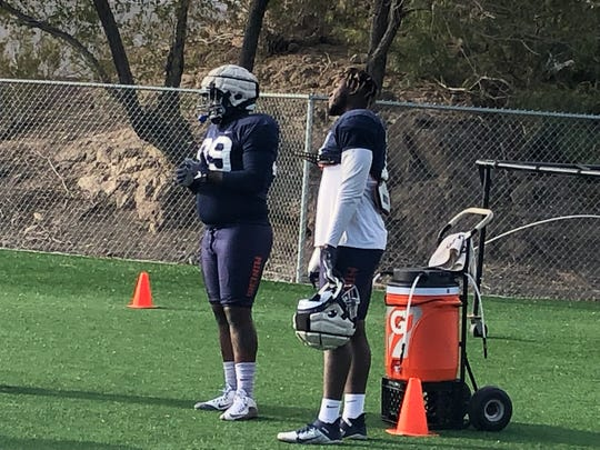 UTEP defensive end Denzel Chukwukelu (right) and Chris Richardson watch a drill Wednesday during practice at Glory Field