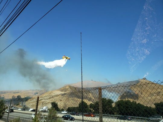 A plane drops water on the Mureau Fire in Calabasas that  started shortly after 10:30 a.m. in an unincorporated area of Los Angeles County at Mureau Road and Mountain View Drive.