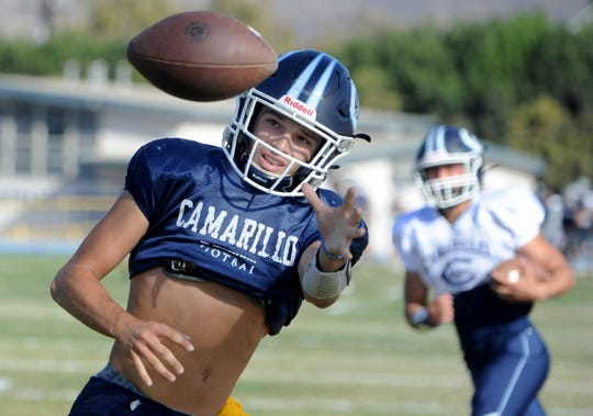 Grady Liddell eyes the ball during Camarillo's practice on Tuesday. Liddell has starred at receiver and cornerback for the unbeaten Scorpions.
