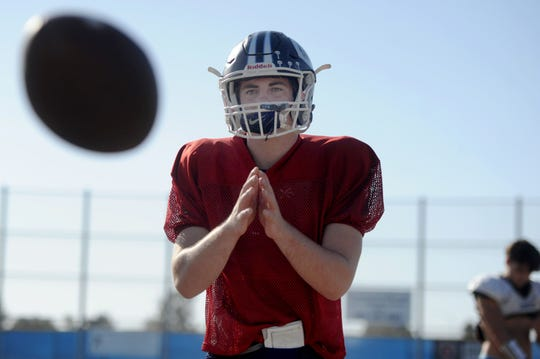 Quarterback James McNamara waits for the snap during Camarillo High's practice on Tuesday. McNamara has thrown for 1,620 yards and 20 touchdowns in nine games for the unbeaten Scorpions.