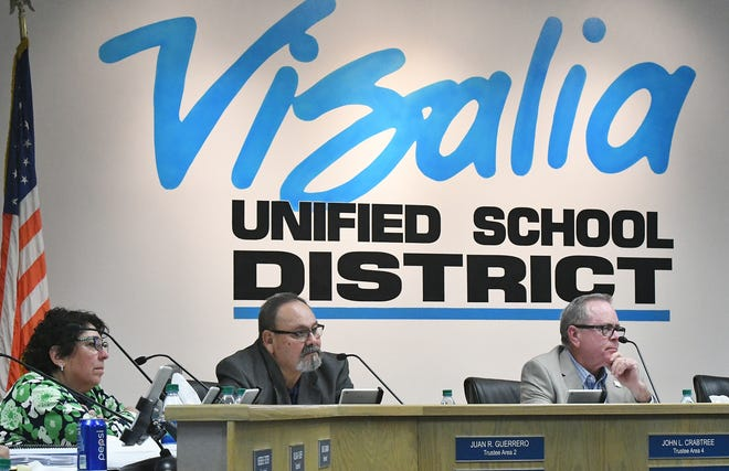 """Visalia Unified trustees listen to an """"open letter"""" at the Oct. 29 school board meeting urging them to open up the search for the district's superintendent position."""