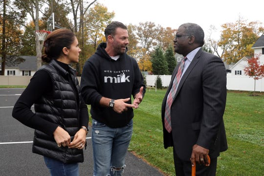 Homeowners Monica and Matthew Marone chat with Deputy County Executive Ken Jenkins after County Executive George Latimer announced that he will propose a 2020 budget that will reduce the county property tax levy for the first time since 2011, outside the Marone's home in Greenburgh Oct. 30, 2019.