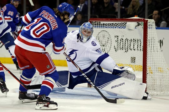 Oct 29, 2019; New York, NY, USA; Tampa Bay Lightning goaltender Andrei Vasilevskiy (88) defends a shot by New York Rangers center Artemi Panarin (10) during the second period at Madison Square Garden.