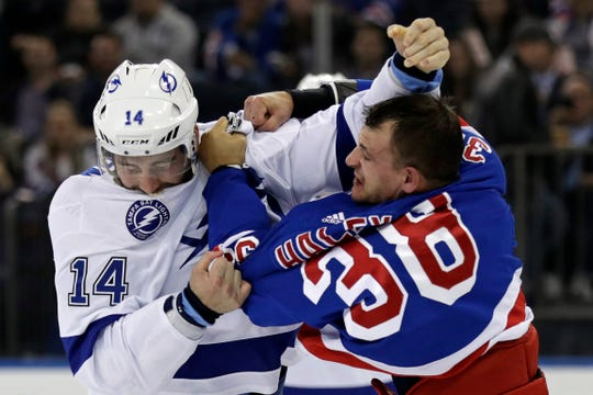 Oct 29, 2019; New York, NY, USA; Tampa Bay Lightning left wing Pat Maroon (14) fights with New York Rangers center Micheal Haley (38) during the first period at Madison Square Garden.