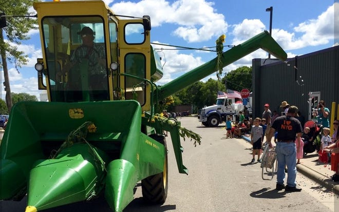 Tom Konz dispenses candy with his 1967 John Deere combine at the Watkins, Minnesota parade.