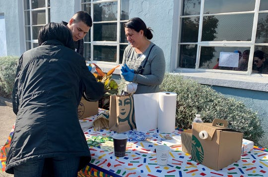 Daisy Carreno hands out free coffee to evacuees from the raging Kincade Fire near Santa Rosa, California.
