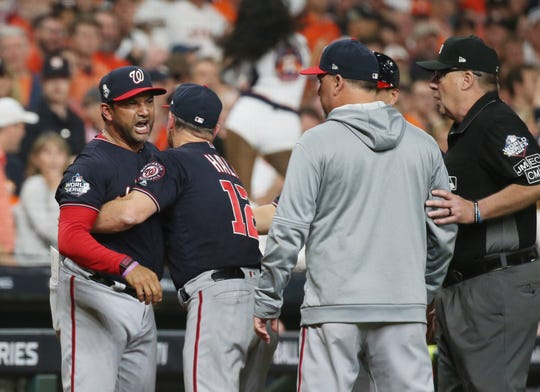 Nationals manager Dave Martinez needed to be restrained by bench coach Chip Hale.