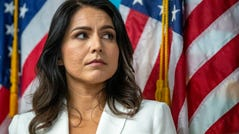 Democratic presidential candidate U.S. Rep. Tulsi Gabbard, D-Hawaii, listens as family members of victims of the terrorist attacks on 9/11 speak during a news conference at the 9/11 Tribute Museum, Tuesday, Oct. 29, 2019, in New York. (AP Photo/Mary Altaffer) ORG XMIT: NYMA110