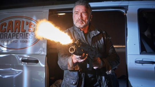 "Arnold Schwarzenegger is equally adept with guns and draperies as the returning T-800 in ""Terminator: Dark Fate."""