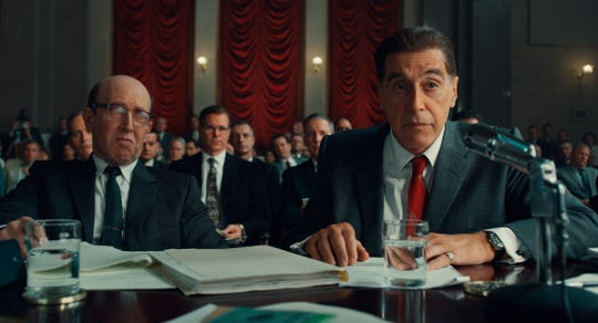 "This image released by Netflix shows Al Pacino, right, in a scene from ""The Irishman."""