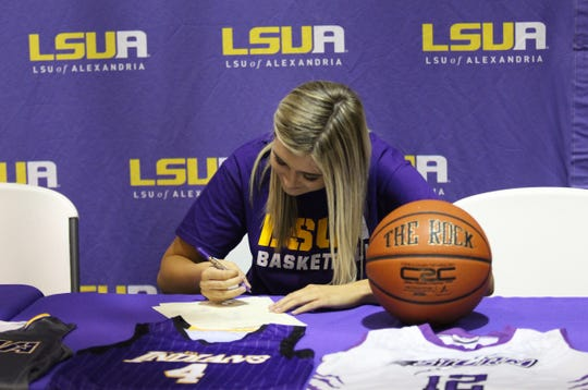 Anacoco senior Payton Miller signs her National Letter of Intent to play basketball at LSU of Alexandria.