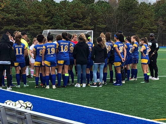 The Spotswood girls soccer team meets with the officials before Thursday's NJSIAA game at the Sayreville Sports Complex on Oct. 31, 2019.