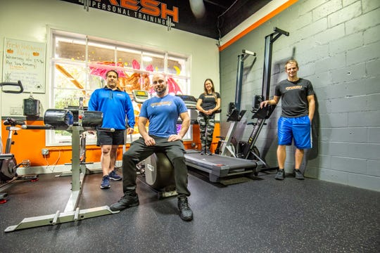 Rob Lantos, sitting, poses with his Fresh Personal Training trainers (from left) trainers Lenny Procopio, Cate Pinkus and Brandon Pinkus at the Little Silver gym.