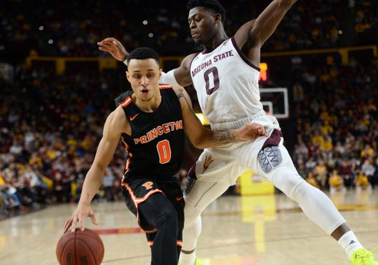 Princeton Tigers guard Jaelin Llewellyn (0) dribbles against Arizona State Sun Devils guard Luguentz Dort (0) in 2018.