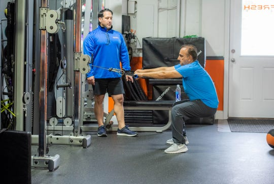 Trainer Lenny Procopio works with client Matt Safari of Little Silver at Fresh Personal Training in Little Silver.