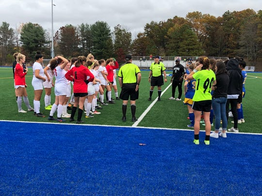 The Point Beach girls soccer team and Spotswood meet with the officials before Thursday's NJSIAA game at the Sayreville Sports Complex on Oct. 31, 2019.