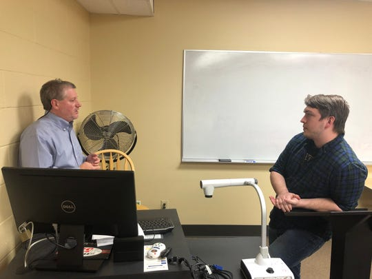 Abilene Christian University professor Neal Coates, left, talks Tuesday about the death of Abu Bakr al-Baghdadi with student Aidan Christian. Coates led a class-long conversation about the recent event in his terrorism class.