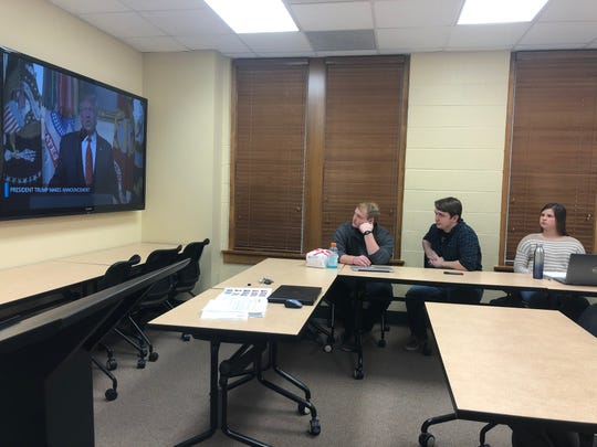 Abilene Christian University students Jonathan Ash, Aidan Christian and Dori Rembecki watch the address given by President Donald Trump during class Tuesday, as professor Neal Coates led a deep dive into the recent death of ISIS leader Abu Bakr al-Baghdadi.