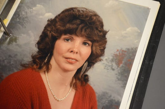 A picture of Gayle Barrus in one of the Battle Creek Police Department report binders about her murder.