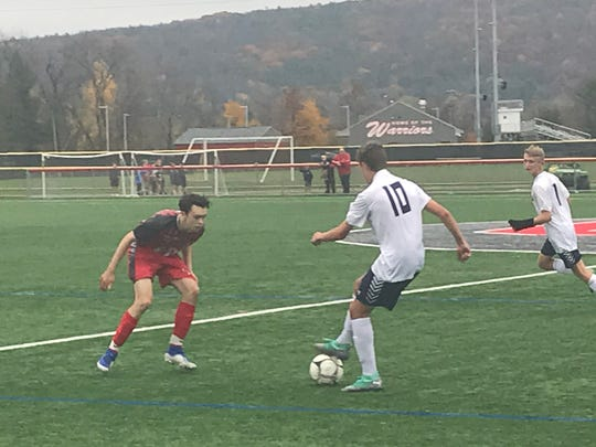 Chenango Forks' Donovan Peterson controls the ball in front of a Chenango Valley defender during Wednesday's Section 4 Class B semifinal at CV. The Warriors rallied for a 3-2 victory.