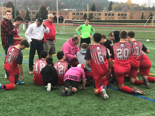 Chenango Valley coach Ted Hoffman talks to his team following its 3-2 victory over visiting Chenango Forks in a Section 4 Class B semifinal Wednesday. The Warriors will play Oneonta in the final Saturday at Wright National Soccer Campus.