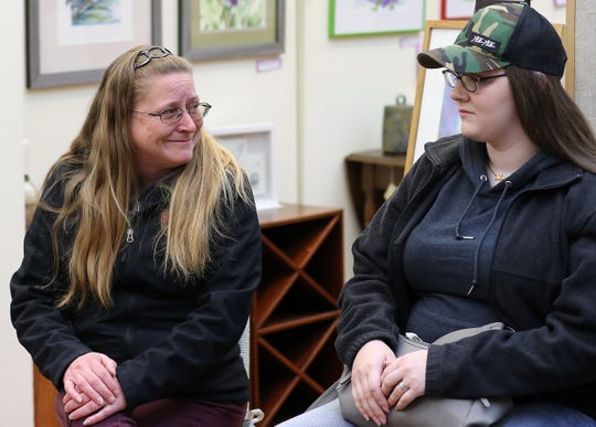 Luella Hauenstein smiles at Tabi Patterson, 17, as they talk about Patterson living with the Hauenstein's as part of the Coffee Oasis host family program, at the Sydney Art Museum in Port Orchard on Wednesday.