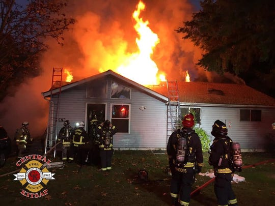 A fire blazes at Dawn Ruth's Silverdale home on the morning of Oct. 30 as Central Kitsap Fire and Rescue works to put it out.