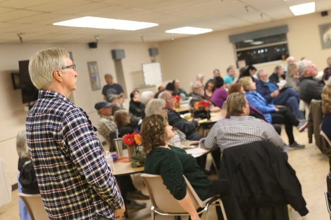 Roland Arper, one of the shelter managers at the Port Orchard United Methodist Church, watches during a volunteer training on Wednesday. Kitsap County is readying its army of volunteers to staff emergency shelters that are activated when temperatures fall.