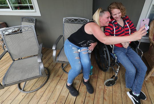 Jacinta Nall, left, takes a selfie with her sister, Tessa, on the porch of the care facility where Tessa lives, in Bellingham in August. The family of Tessa Nall is suing Kitsap County in federal court after she injured herself in a second suicide attempt at the jail shortly after being released from solitary confinement.