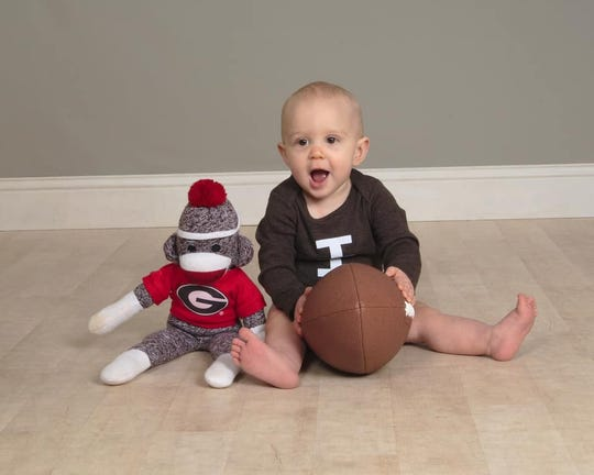 Rockledge's Barrett Billings, who turns 1, will be having a college football-themed party Saturday during the Florida-Georgia rivalry game. Bet you can guess who he will be rooting for.