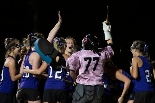 Bellows Falls celebrates the win during the field hockey semifinal game between Bellows Falls Union and Champlain Valley Union at Middlebury College on Wednesday October 30, 2019 in Middlebury, Vermont.