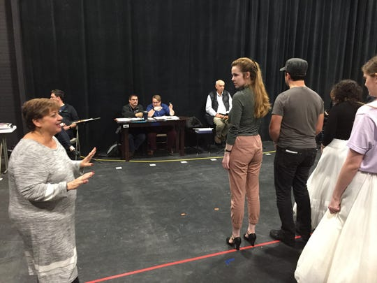"Freda Tutt, left, director of Lyric Theatre's ""The Addams Family,"" speaks with the cast during a rehearsal in South Burlington on Oct. 23, 2019."