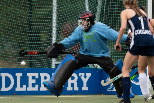 MMU goalie Marcelle Barber tries to make a save during the field hockey semifinal game between the Mount Mansfield Cougars and the Rice Green Knights at Middlebury College on Wednesday afternoon October 30, 2019 in Middlebury, Vermont.