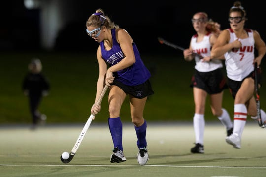 Bellow's Falls' Maya Waryas (14) runs down the field with the ball during the field hockey semifinal game between Bellows Falls Union and Champlain Valley Union at Middlebury College on Wednesday afternoon October 30, 2019 in Middlebury, Vermont.