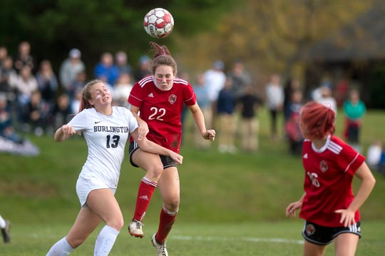 Champlain Valley's Josie Pecor, center, wins a header during a Division I high school girls soccer semifinal in Hinesburg on Wednesday, Oct. 30, 2019.